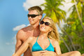 Young couple enjoying their vacation beautiful at maldives portrait with sunglasses and palm trees at background close up Royalty Free Stock Photos