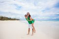 Young couple enjoying their vacation and have fun on a tropical beach this image has attached release Stock Images