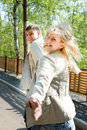 Young couple escaping and smiling Royalty Free Stock Photos