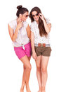 Young couple female friends laughing on white background Royalty Free Stock Photography