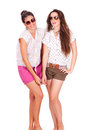 Young couple female friends laughing on white background Stock Photos