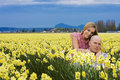 Young Couple in a field of flowers Royalty Free Stock Photography