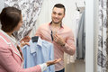 Young couple at fitting room Royalty Free Stock Photo