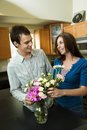 Young couple with flowers Royalty Free Stock Photo