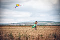 Young couple flying a kite Royalty Free Stock Photo