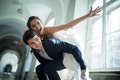 Young couple fooling around bride groom climbed on his back and spread his hands wide show plane Royalty Free Stock Photos