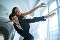 Young couple fooling around bride groom climbed on his back and spread his hands wide show plane Stock Photo