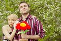 Young couple in the garden smiling and in love Stock Photo