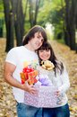 Young couple with gift boxes Stock Photography