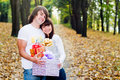 Young couple with gift boxes Stock Images
