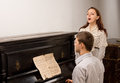 Young couple giving a singing recital Royalty Free Stock Images