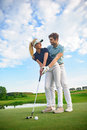 Young couple on golf course Royalty Free Stock Photo