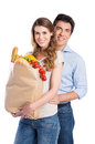 Young couple with grocery bag portrait of happy isolated on white background Stock Photos