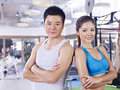 Young couple in gym asian standing back to back fitness center Stock Image