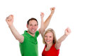 Young couple with hands with arms up happy in front of white background Royalty Free Stock Image
