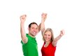 Young couple with hands with arms up happy in front of white background Royalty Free Stock Photos