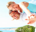 Young couple hands raised enjoying themselves Stock Photos