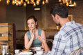 Young couple having an argument at the cafe Royalty Free Stock Photos