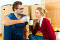 Young couple having break while moving in Royalty Free Stock Photo