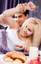 Young couple having breakfast in bed Stock Images