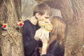 Young couple having covered candy kisses Stock Images