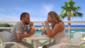 Young couple having drinks at sea Royalty Free Stock Photo