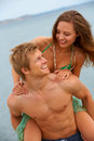 A young couple having fun on the beach Stock Photography