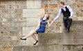 Young couple having fun at the embankment Royalty Free Stock Photos