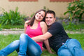 Young couple having fun in the garden on beautiful spring day Royalty Free Stock Image