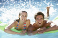 Young Couple Having Fun With Inflatable Airbed Swimming Pool Together Royalty Free Stock Photo