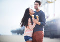 Young couple having fun at santa monica pier photo of a with ice cream Royalty Free Stock Photography
