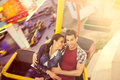 Young couple having a ride on a ferris wheel Royalty Free Stock Photo