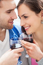 Young couple having toast smiling Royalty Free Stock Photos