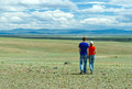 Young couple hiking steppe Stock Photos