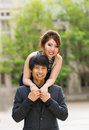 Young couple holding each other outdoors vertical photo of adult women looking over his shoulder expressing their affection with Royalty Free Stock Photo