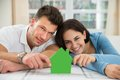 Young couple holding green house model Royalty Free Stock Photo