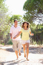 Young couple, holding hands, walking,walk in park Stock Image