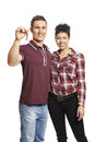 Young couple holding set of house keys Royalty Free Stock Photo