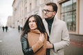 Young couple hugging on the city street in winter Royalty Free Stock Photo