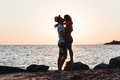 Young couple hugging and kissing on a beach Royalty Free Stock Photo