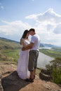 Young couple hugging in mountains happy with river on background Stock Photography