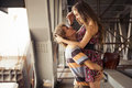 Young couple hugging in the summer daylight on a bridge construc Royalty Free Stock Photo