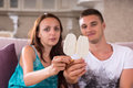 Young Couple with Ice Cream Bars Sitting on Sofa Royalty Free Stock Photo