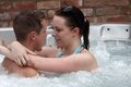 A young couple in the jacuzzi Stock Image