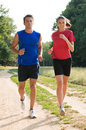 Young couple jogging portrait of a healthy outdoors Stock Photography