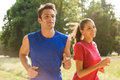 Young couple jogging together healthy in bright sunny day Royalty Free Stock Photography