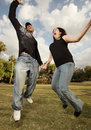 Young couple jumping in the air Stock Image