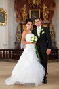 Young couple just married inside of church wedding Stock Photo