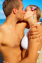 A Young Couple Kissing on the Beach Stock Images