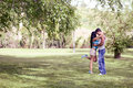 Young couple kissing in a beautiful park attractive Stock Image